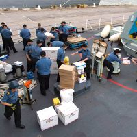 Crew members from HMCS St. John's receive supplies at Norfolk Naval Base in West Virginia before departing on Operation Renaissance. Photo by MCpl Chris Ringius, Formation Imaging Services Halifax