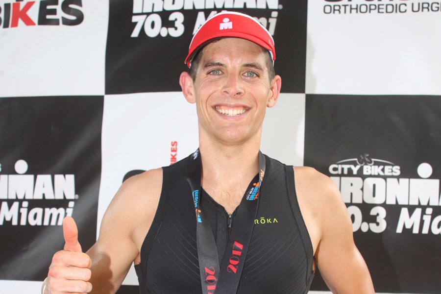 Lt(N) Nico Lightbody at the finish line of the Ironman Miami 70.3 competition. Photos by FinisherPix