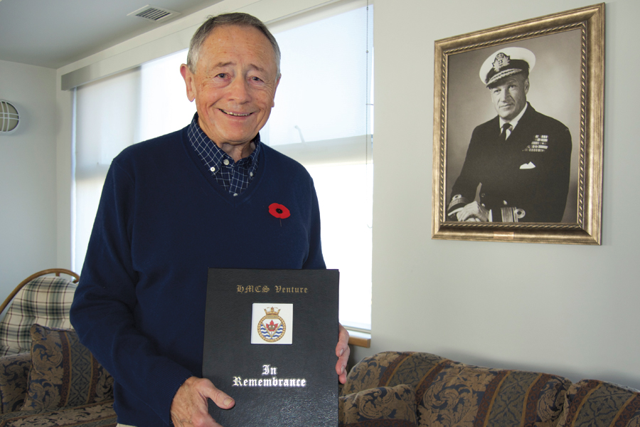 HMCS Venture graduate retired Capt(N) Wilf Lund displays the Venture Book of Remembrance in the Welland Room at Work Point. Photo by Peter Mallett, Lookout Newspaper