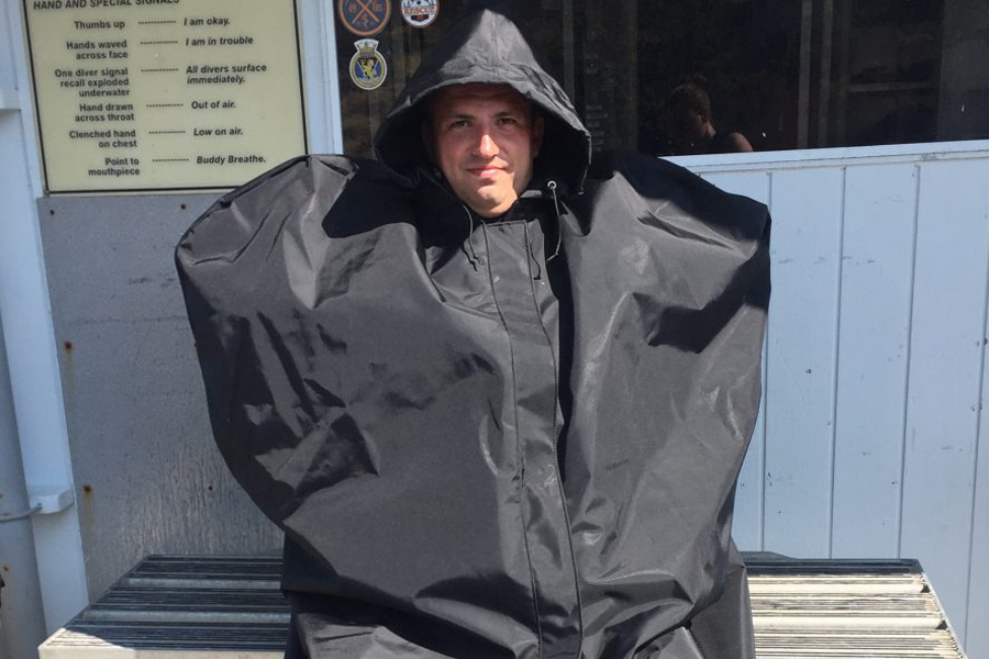 Leading Seaman Glen Straarup, Fleet Diving Unit (Pacific), tries out the Standby Diver Over Garment during a recertification course. Photo by Master Seaman Sara MacAleese