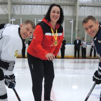 Invictus Games 2017 gold medal winner Lt(N) Krista Seguin is joined by Esquimalt Tritons' Capt(N) Jason Boyd (right) and Comox Flyers' MCpl Alex Coles for the ceremonial opening puck drop to commence the Men's Pacific Region Hockey qualifier at the Wurtele Arena Dec. 4. Photo by Peter Mallett, Lookout