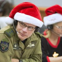The Royal Canadian Air Force's Major-General Christopher Coates listens intently to a caller during the 2016 NORAD Tracks Santa Event at Peterson Air Force Base in Colorado. Major-General Coates is director of NORAD Operations at NORAD's bi-national headquarters at Peterson AFB. Photo by Dennis Carlyle, NORAD