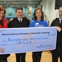Left: Hazel Braithwaite, United Way of Greater Victoria Director of Community Campaign; Base Chief, Chief Petty Officer Gino Spinelli; Julie Mills, HealthPartners Accounts Manager; and Captain (Navy) Jason Boyd, Base Commander, display a cheque for $300,000 from the National Defence Workplace Charitable Campaign. Photo by Peter Mallett, Lookout