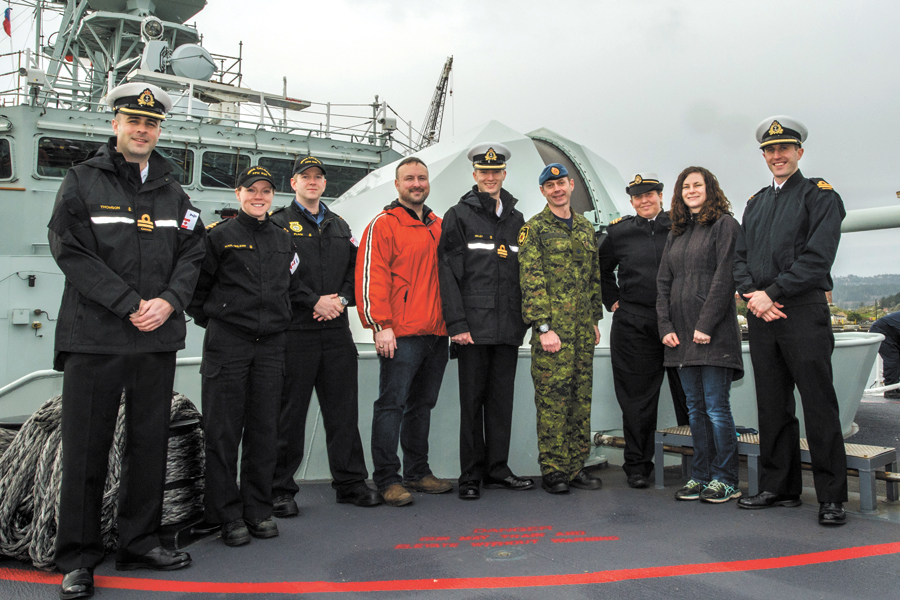 "Team ""Onward"" on HMCS Calgary, 57mm main gun in the background. From left to right: Lt(N) Adam Thomson, Lt(N) Sonja Maul-Wilson, SLt Sean Place, Adam Checketts, Team captain Lt(N) Sean Milley, Team captain Warrant Officer Steven Lewington, Lt(N) Cass van Benthem Jutting, Dusty Johnston, and Lt(N) Alex Johnston. Absent: Third team captain Lt(N) Stephen Tomlinson, who is undergoing treatment."