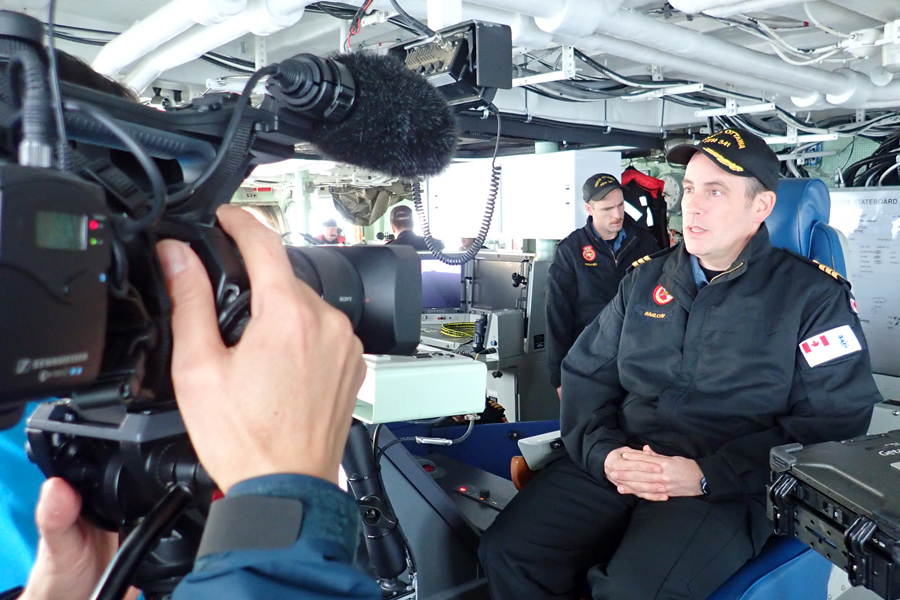 Clement Tang of Chinese-language cable specialty channel Fairchild TV (not pictured) interviews Cdr Alex Barlow, Commanding Officer of HMCS Ottawa, on the ship's bridge. The TV crew sailed aboard the frigate to get an up-close look at life in the navy. Photos courtesy Fairchild TV