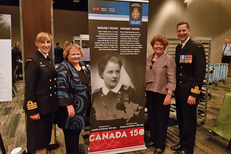 Cdr Michele Tessier, Margaret and Alyson Brooke, and Commander Canadian Fleet Atlantic Cmdre Craig Skjerpen.