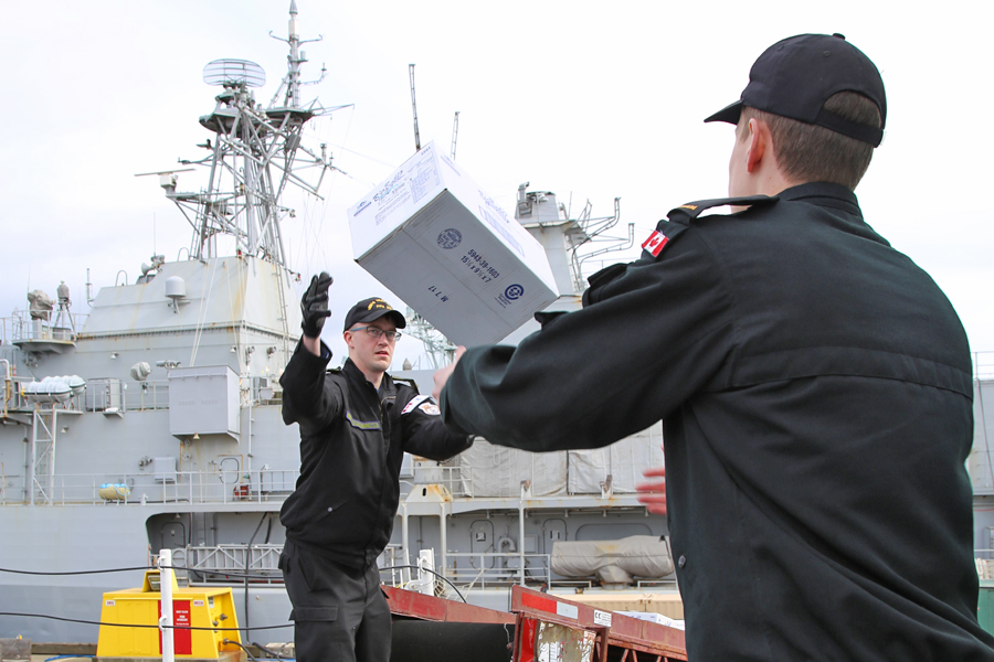 Crewmembers from HMCS Vancouver were busy last week filling the ship's stores in preparation for their departure. Photo by SLt M.X. Dery, MARPAC PAO