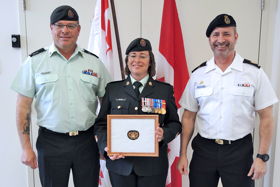 "Master Warrant Officer Sibylle Michel is joined by her two brothers (left) MWO Renaud ""Mich"" Michel and Chief Petty Officer Second Class Max Michel following a promotion ceremony at the Joint Personnel Support Unit (JPSU). Photo by Peter Mallett, Lookout"
