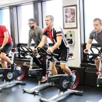 Members of the HMCS Fredericton 'Sailor for Wishes' team train with a spin class at the Shearwater gym. Photo by Ryan Melanson, Trident Newspaper