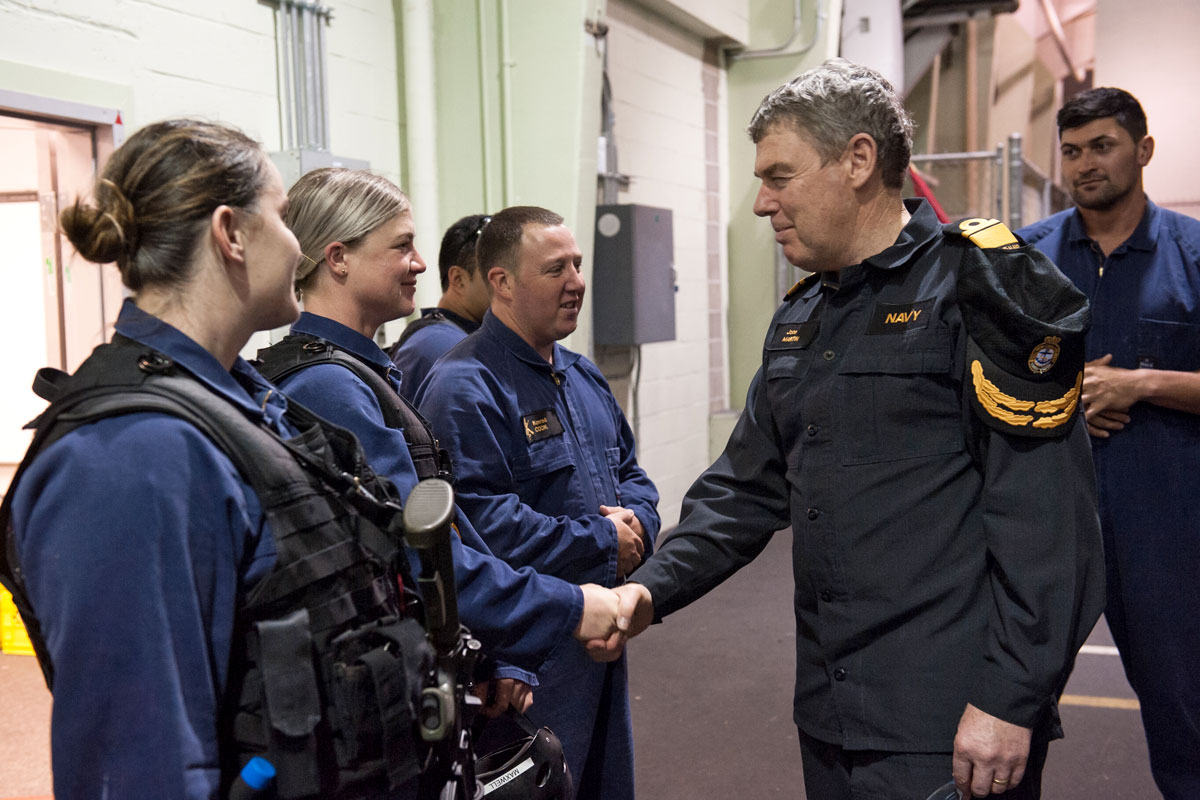 Rear Admiral John Martin, New Zealand Chief of the Navy, shakes hands with Leading Seamanship Combat Specialist Emily Maxwell during his visit to the Naval Boarding Party cell at Work Point. He was in town to see the progression of the Te Kaha refit.