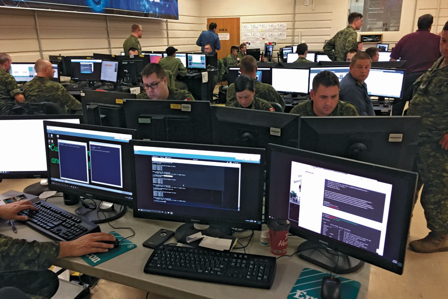 Participants team up to complete a challenge during exercise Cyber Challenge last year.