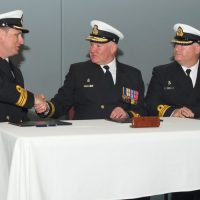Commanding Officer of the Naval Security Team, Lieutenant Commander Michael Wills (left), is congratulated by Commander Canadian Fleet Pacific, Commodore Jeff Zwick (centre) during a Change of Command Ceremony on May 11. LCdr Wills took command of the unit from LCdr Jeff Chura (right). Photo by LS Ogle Henry, MARPAC Imaging Services