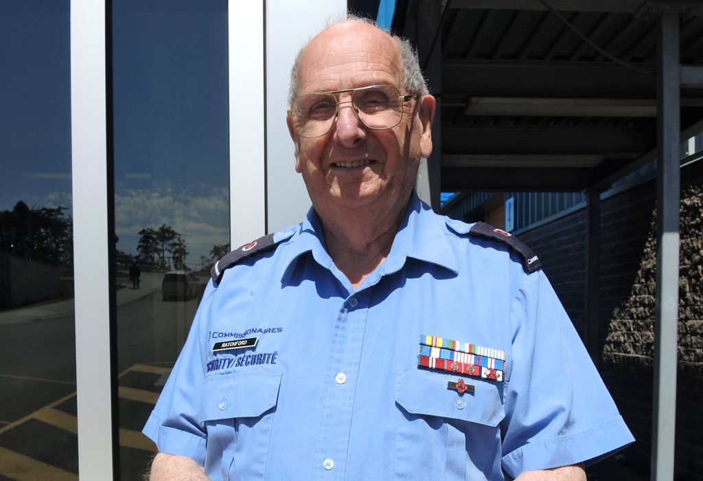 Security Commissionaire and Royal Canadian Navy veteran Gerry Ratchford at his post at the Fleet Maintenance Facility security booth. The 90-year-old recently celebrated his 90th birthday. Photo by Peter Mallett, Lookout