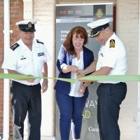 From left: Chief Petty Officer First Class Gino Spinelli,  Base Chief; Alison Arnesen, Conflict and Complaint Management Services Regional Manager; Captain (Navy) Jason Boyd, Base Commander, snip the ribbon to officially open the Conflict and Complaint Management Service Centre on June 4. Photo by LS Alex Ilareguy, Lookout
