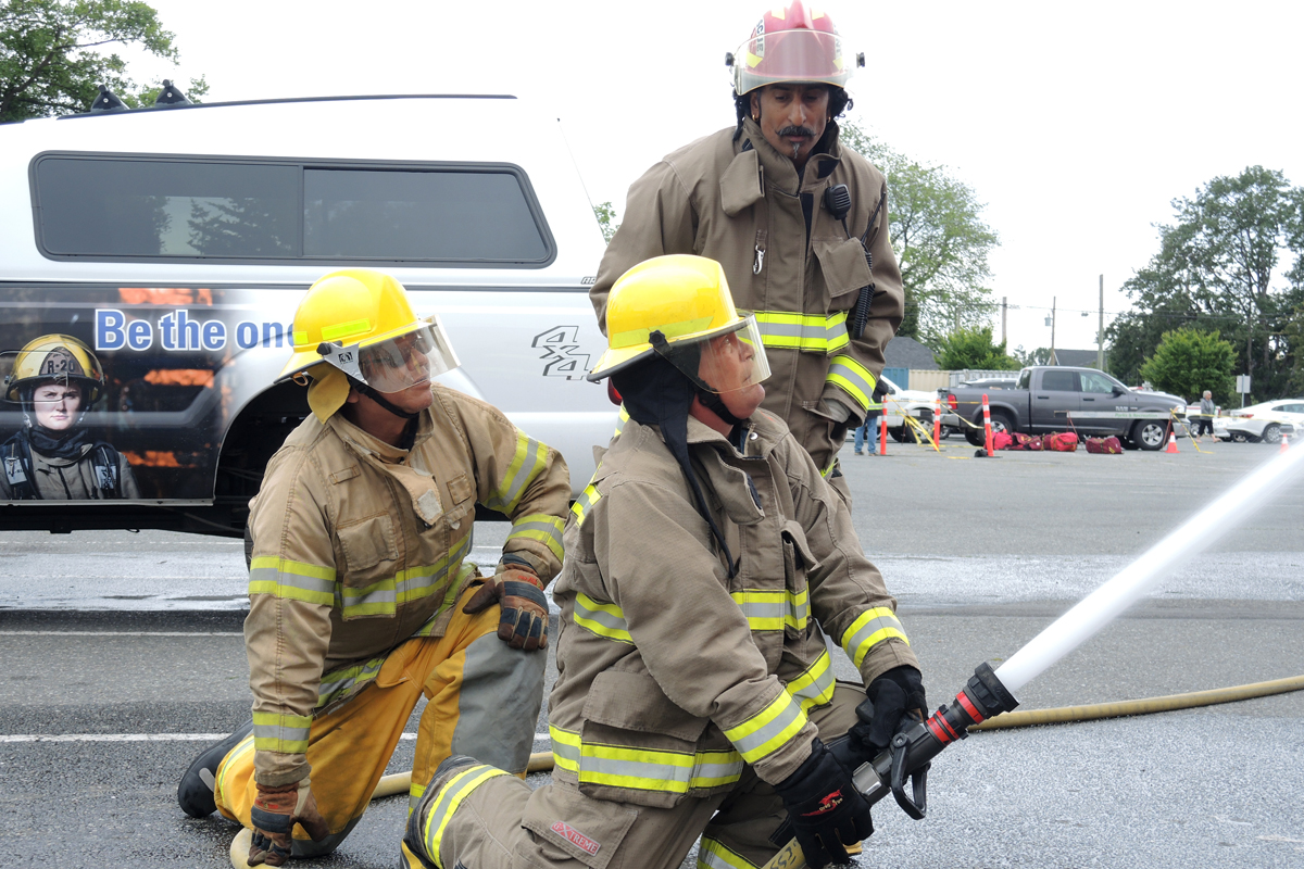 Members of the B.C. First Nations Services Society (FNESS) work to perform an exterior attack on a live fire simulator (not pictured) on June 4 at the Archie Browning Sports Centre. Photos by LS Alex Ilareguy