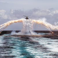 Her Majesty's Canadian Ship REGINA's CH-124 Sea King helicopter deploys flares during a routine flight operation in the Indian Ocean on August 14, 2014. Photo by Cpl Michael Bastien, MARPAC Imaging Services