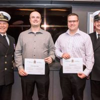 From left: RAdm Craig Baines, Commander Maritime Forces Atlantic, LS Kenneth Squibb, LS Steven Auchu, and Formation Chief, CPO1 Pierre Auger at the re-enrollment ceremony at CFRC Halifax on June 7. Photo by Mona Ghiz, MARLANT PA