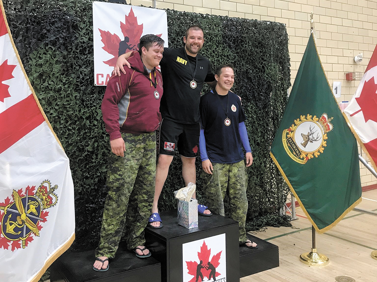 MS Thibault receives his gold medal at the CAF Combatives Grappling Tournament.