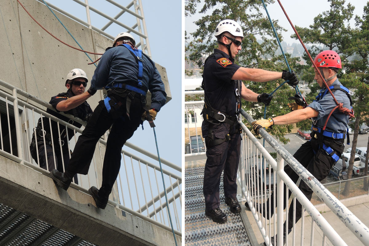 Firefighter Jon MacDonald helps Able Seaman Conner Dulisch repel from a training tower at the CFB Esquimalt Fire and Rescue Aug. 20. Photo by Peter Mallett, Lookout Newspaper