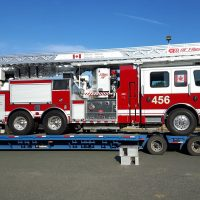 The new Aerial Ladder Fire Fighting Vehicle is unloaded from a transport truck at CFB Esquimalt's Transport Electrical and Mechanical Engineering (TEME). The new apparatus is one of nine fire trucks being delivered to bases across the country this year. Photo Credit: CFB Esquimalt Fire and Rescue