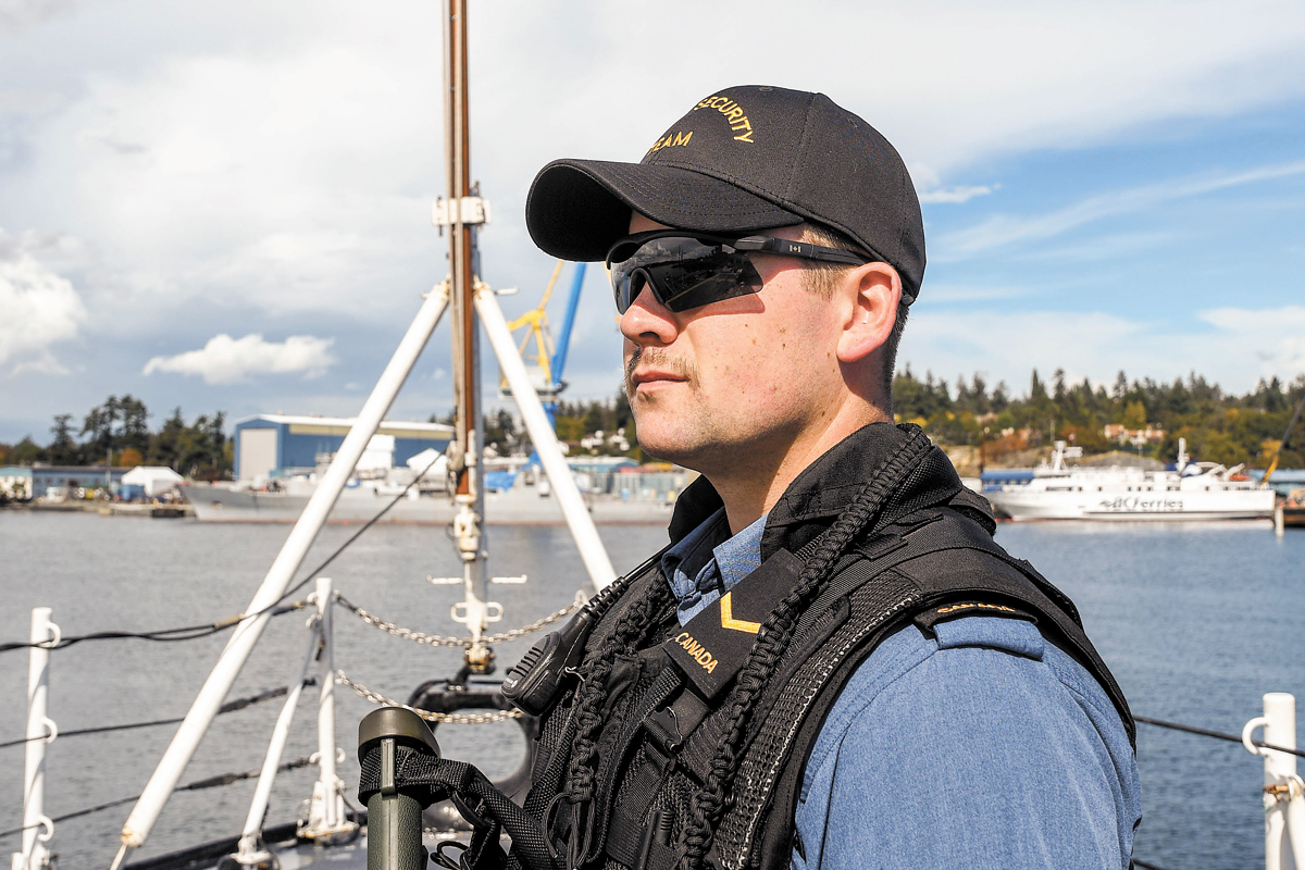 AB Darcey Tieincy on watch as upper deck sentry aboard HMCS Vancouver during the sea training validation phase prior to deployment. Photos by SLt M.X. Déry