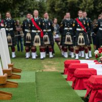 Soldiers from the Canadian Scottish Regiment of Victoria and the Royal New Brunswick Regiment of Fredericton stand at ease alongside the final resting place of four Canadian First World War soldiers who died at the Battle of Hill 70. Photos by MCpl True-dee McCarthy, CF Combat Camera