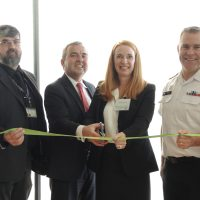 Mark Miller, UNDE; Glenn MacDougall, Acting DGWM; Nicole Schaaf, Office of Disability Management, and Capt(N) Jason Boyd cut the ribbon marking the regional office of Disability Management opening. Photo by Peter Mallett