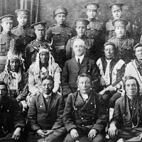 Elders and Indigenous soldiers in the uniform of the Canadian Expeditionary Force circa 1916-17.