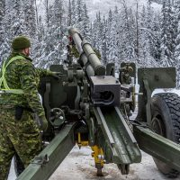 A gunner from the 1st Regiment, Royal Canadian Horse Artillery, prepares for a bore sight inspection of the C3 105mm Howitzer by the Parks Canada Agency. Photo by SLt M.X Dery