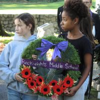 Wreath bearers from Rockheights Middle School take part in a moment of silence. Photo by Peter Mallett, Lookout