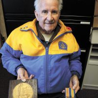LS (Retired) Wayne Archibald displays the medals of his father Private Issac Archibald of Truro, N.S., who fought for Canada in France during the First World War. Photo by Peter Mallett, Lookout