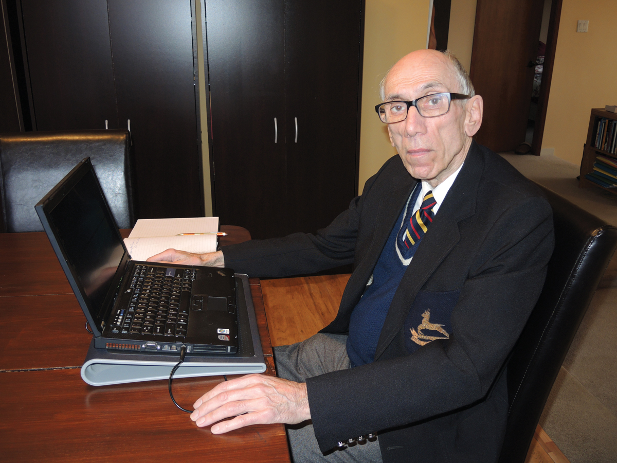 Retired Canadian Army Major Gary Del Vallano works on a project for Royal United Services Institute Vancouver Island (RUSI-VI) at his home in Victoria. Del Vllano, 80, enjoyed a 38-year military career and is the director of RUSI-VI Military Oral History program. Photo by Peter Mallett, Lookout