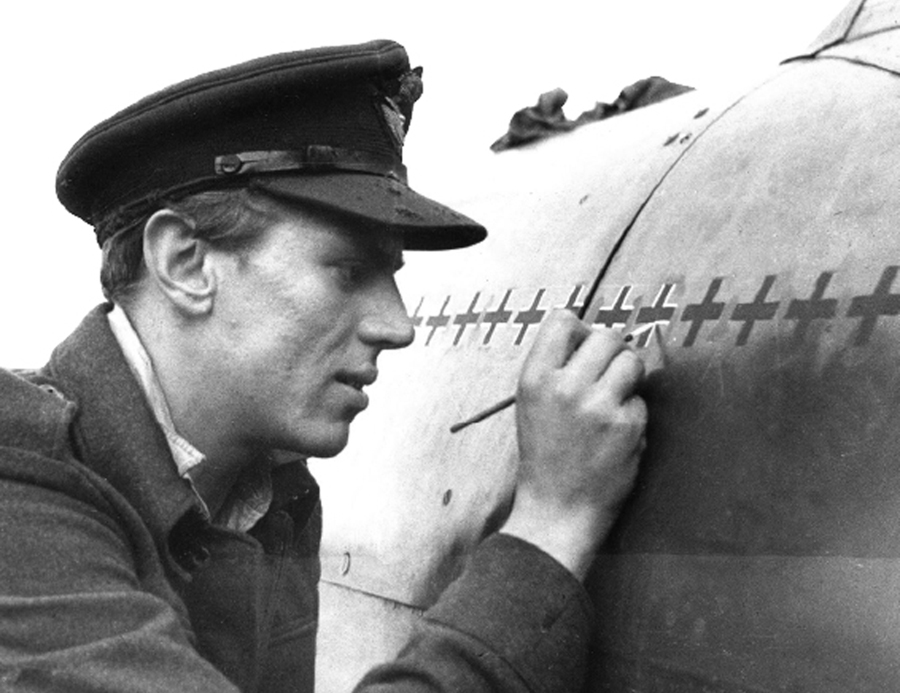 """With meticulous care, Beurling chalks up his """"kills"""" on the fuselage of his Spitfire."""