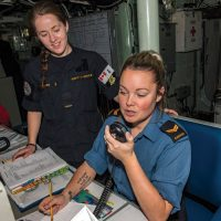 Ordinary Seaman Kathryn Struthers (left) and Leading Seaman Chrystal Lavigne (right), Naval Communicators, stand watch on HMCS Calgary's bridge during Operation Projection.