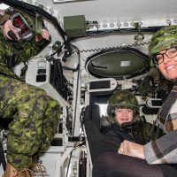 Honorary Lieutenant-Colonel, for the day, Aiden Anderson, along with his sister Courtney Holland and mother Isabella Anderson, experienced army equipment during their visit to Le Régiment de Hull (RCAC), in Gatineau, Quebec, on Dec. 13. Photo by Jay Rankin, Canadian Army Public Affairs