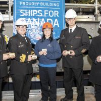 From left: CPO1 Derek Kitching, Atlantic Fleet Chief; RAdm Craig Baines, Commander Maritime Forces Atlantic; Irving Shipbuilding employee Vicki Berg; CPO1 Sylvain Jaquemot, Pacific Fleet Chief, and Rene Belliveau, Irving Shipbuilding VP, Production, at the keel-laying ceremony on Dec. 6, 2018, with a plaque as a memento. Photo by Mona Ghiz, Marlant PA