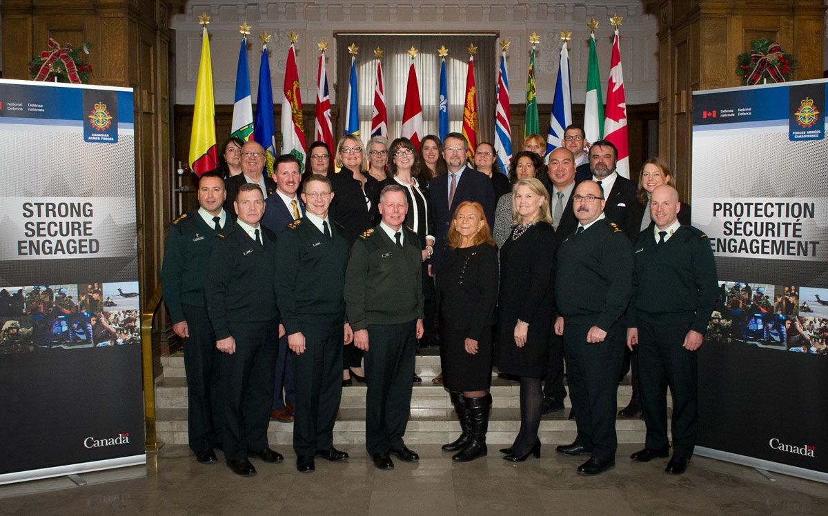 Members of Seamless in Canada pose for a group photo at the Chateau Laurier in Ottawa, Ontario, on Dec. 5. Photo by Private Tori Lake, Canadian Forces Support Unit (Ottawa) Imaging Services