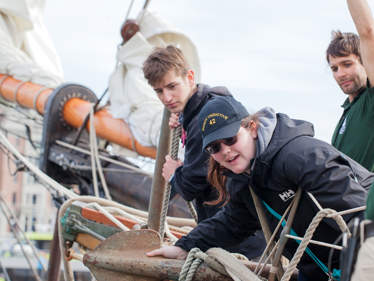 Bosun Brock directs cadets Cassandra and Hunter as they prepare to come alongside in Victoria Harbour on the deck of S.A.L.T.S. schooner Pacific Swift. Photo by Christa Brunt