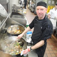 LS Robbie McDougall of Base Foods showcases his special cod fillet meal in the kitchen at Nelles Block. Photo by Peter Mallett, Lookout