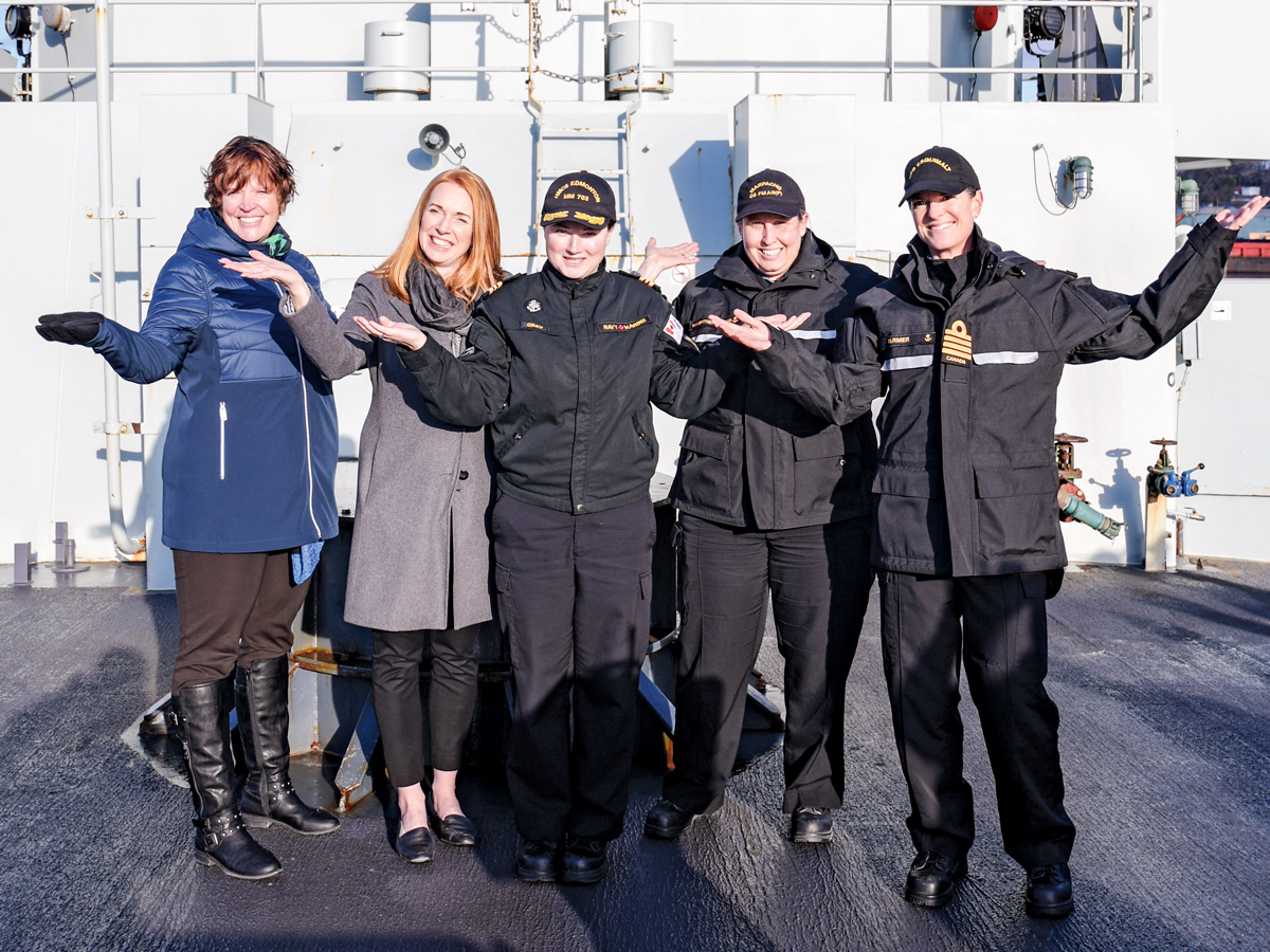 Just before departing on a day sail in HMCS Edmonton as part of International Women's Day, Jennifer Gervès-Keen, Nicole Schaaf, LCdr Kristina Gray, Lt(N) Cass van Benthem Jutting, and HCapt(N) Mandy Farmer struck a pose to demonstrate this year's theme of Better the Balance, Better the World. Photo by SLt M.X. Déry