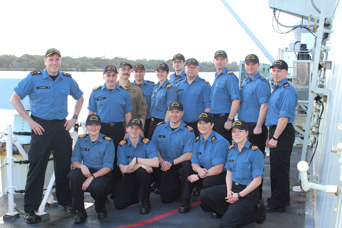 Commodore Topshee and his staff pose as OTTAWA enters Pearl Harbor.