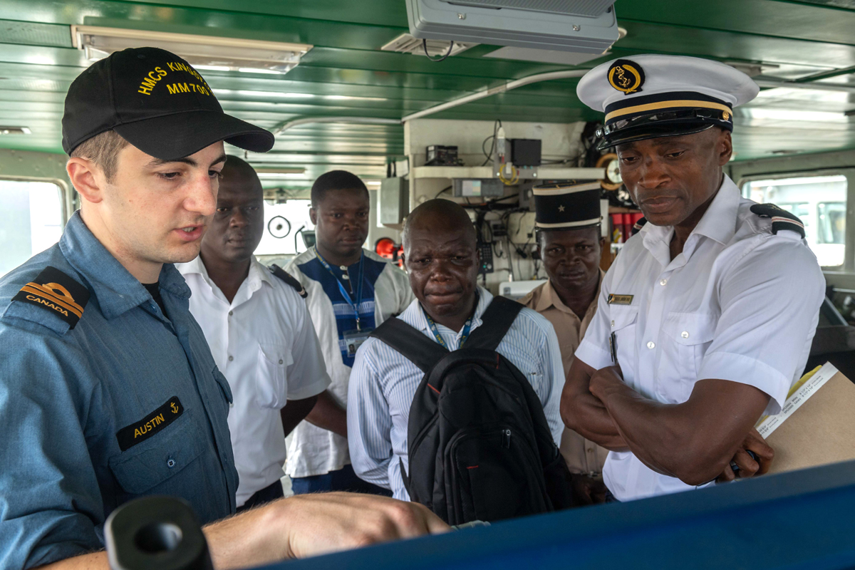 HMCS Kingston Navigating Officer Lt(N) Graham Austin discusses search-and-rescue strategies with Togolese military and government personnel on March 7. Photo by Cpl David Veldman
