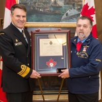 "AB (Retired) Allan ""Dinger"" Bell, a survivor of the 1969 HMCS Kootenay explosion, was presented the Wound Stripe on by VAdm Ron Lloyd, Commander Royal Canadian Navy. Photo by AB John Iglesias, FIS"