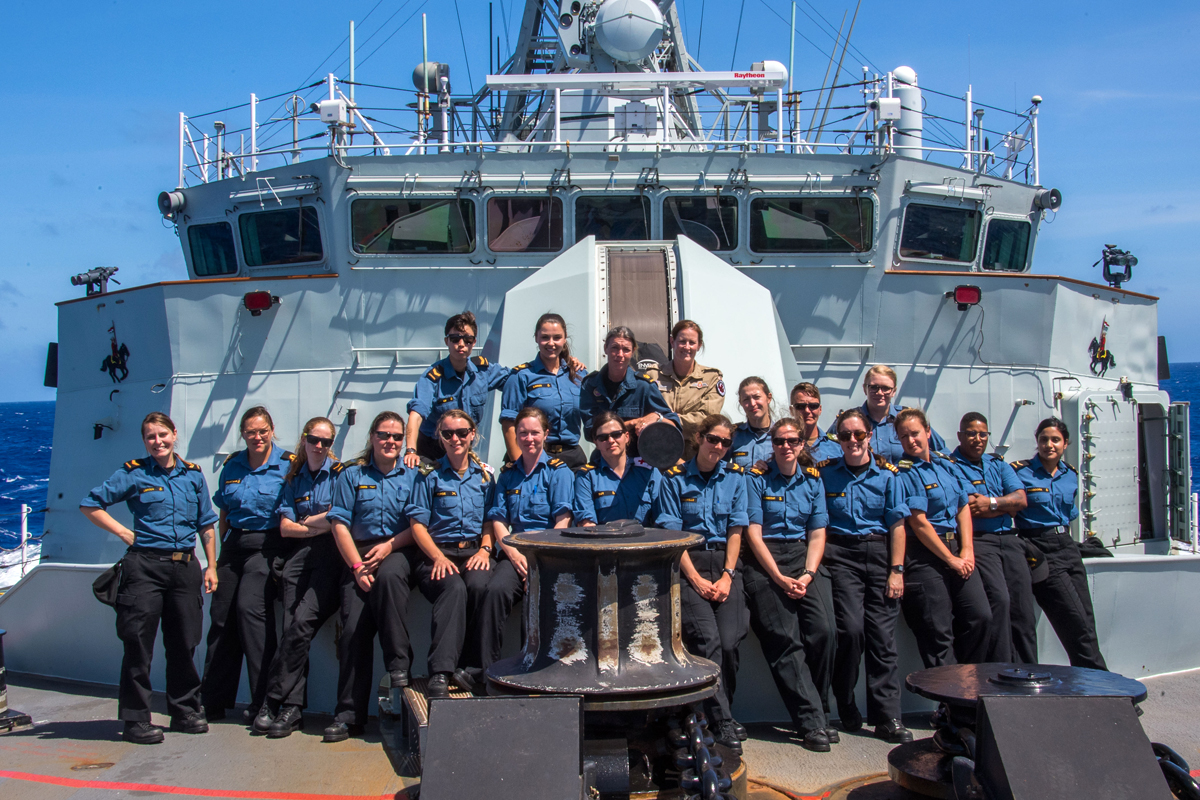 HMCS Regina's female crew members pose for a photo to celebrate International Women's Day on the Pacific Ocean during Operation PROJECTON on March 10. Photo by Corporal Stuart Evans, Borden Imaging Services