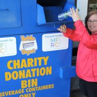 Lisa Church, Military Family Resource Centre (MFRC) Esquimalt Community Engagement Manager, drops a beverage container into the new Bottle Depot community donation bin at the CANEX convenience store in Colwood. Proceeds from donations will go to support the MFRC's deployment programs. Photo by Peter Mallett, Lookout