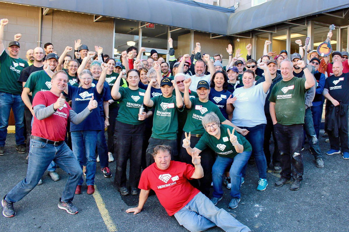 HeroWork volunteers gather for a group photograph after completing a Radical Renovation at the Mustard Seed Food Bank in October 2018. Photo by Terri Kott, HeroWork