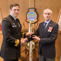 Cmdre Angus Topshee presents Cdr (Retired) Al Kennedy with athe Wound Stripe on May 14. Kennedy was severely injured in the HMCS Kootenay explosion on Oct. 23, 1969. Photo by SLt Michael Déry