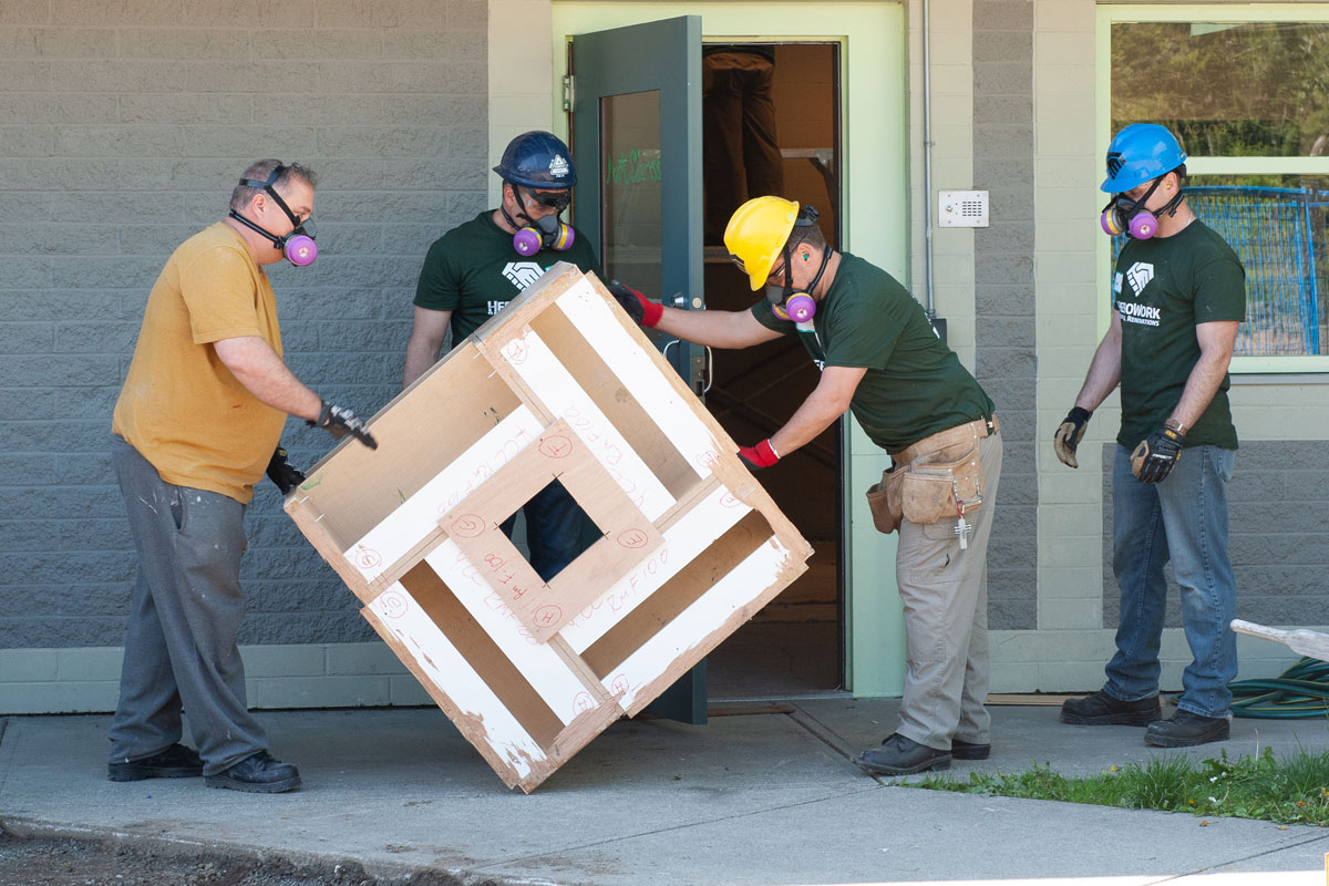 Military members remove a table from the former detention centre. Photo by John Penner/ John's Photography