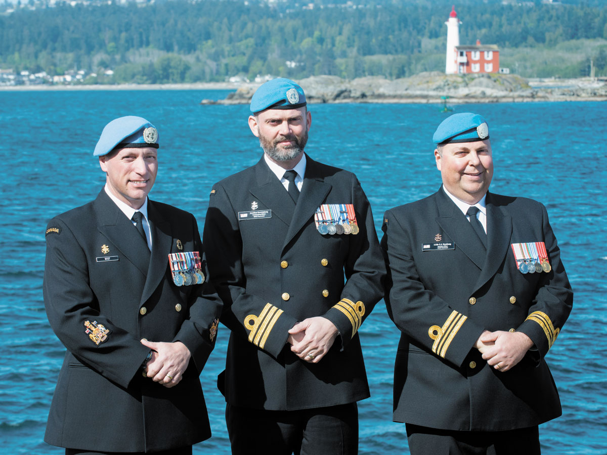 From the left: Chief Petty Officer First Class Steve Wist, Commander Jonathan Kouwenberg, and Lieutenant-Commander Collin Forsberg wear their United Nations blue beret in recognition of International Day of United Nations Peacekeepers and their own service in Operation Safari. Photo by Leading Seaman Sisi Xu, MARPAC Imaging Services