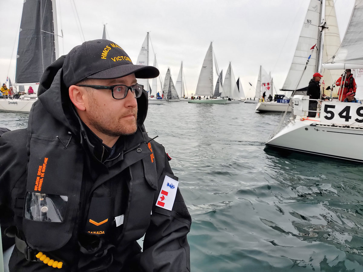AB Nick Reicker, from HMCS Malahat, observes the busy waters of the Swiftsure start line from the unit's RHIB.